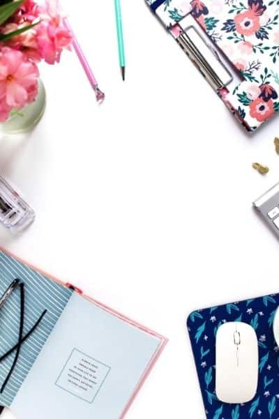 image of desktop with floral office supplies