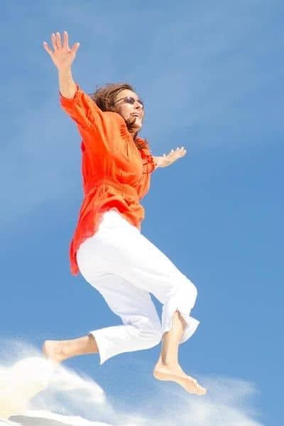 image of woman jumping in air